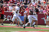 NWA Democrat-Gazette/Michael Woods --04/25/2015--w@NWAMICHAELW... University of Arkansas running back Kody Walker slips past De'Andre Coley to score a touchdown during the 2015 Red-White game Saturday afternoon at Razorback Stadium in Fayetteville.