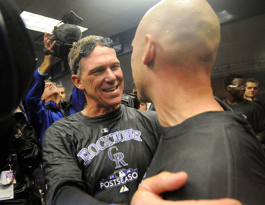 01 October 2009: Rockies manager Jim Tracy celebrates with 2nd baseman Clint Barmes after being soaked in champagne and beer after the final regular season home game at Coors Field between the Milwaukee Brewers  and the Colorado Rockies at Coors Field in Denver, Colorado. The Rockies beat the Brewers 9-2 and clinched a playoff berth via the National League Wild Card with the win.  *****For Editorial Use Only*****