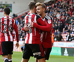 Kieron Freeman celebrates Harry Chapman of Sheffield Uniteds goal during the Emirates FA Cup Round One match at Bramall Lane Stadium, Sheffield. Picture date: November 6th, 2016. Pic Simon Bellis/Sportimage
