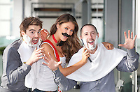 "NO REPRO FEE. 10/11/2011. Miss Universe Ireland Aoife Hannon with Sandy Cole and Christopher White are pictured at the Gibson Hotel Dublin in aid of Movember. The gibson hotel is rockin' a lot of Mo love this November all in aid of Movember, the phenomenal moustache growing global campaign to raise awareness and funds for men's health especially prostate cancer. Today, Thursday 10th November, ""Mo Bro' staff at the gibson hotel were joined by Miss Universe Ireland Aoife Hannon and Neil Rooney from Movember Ireland to show how the gibson hotel's Movember antics are ""growing"" along!One of Dublin's hippest venues, the gibson hotel right in the heart of our emerging music and cultural hub in the Docklands is proud to embrace Movember with gusto with 12 staff members signed up for the annual moustache growing challenge and the hotel will be donating €1 from every Bacardi Mojito and bottle of Corona sold during the month of November. They have also built a custom made ""Get your Mo On"" carnival board for anyone passing through the hotel to try on a mo , have their picture taken and make a donation to Movember. Picture James Horan/Collins"