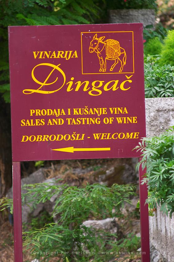 Sign pointing to the winery Vinarija Dingac with a sign of donkey. Potmje village, Dingac wine region, Peljesac peninsula. Dingac village and region. Peljesac peninsula. Dalmatian Coast, Croatia, Europe.