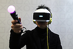 March 27, 2016, Tokyo, Japan - Japan's Sony Computer Entertainment employee demonstrates the newly developed PlayStation VR which will go on sale in October at Anime Japan in Tokyo on Sunday, March 27, 2016. PlayStation VR uses a 5.7-inch OLED HMD and 3D audio headphones to offer a virtual reality videogame world to users. (Photo by Yoshio Tsunoda/AFLO) LWX -ytd-