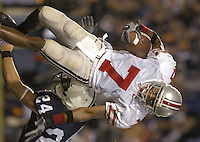 08 October 2005:  Ted Ginn (7) is tripped up by Nolan McCready (24)..The Penn State Nittany Lions knocked off the #6 Ohio State Buckeyes 17-10 October 8, 2005 at Beaver Stadium in State College, PA..