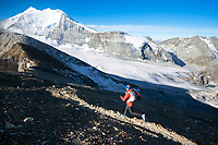 Running down from the summit of the Barrhorn, Europe's highest trail, during the Via Valais, a multi-day trail running tour connecting Verbier with Zermatt, Switzerland.