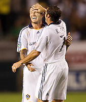 LA Galaxy midfielders David Beckham and Chris Klein celebrate their victory. The LA Galaxy defeated Chivas USA 1-0 to win the final edition of the 2009 SuperClásico at Home Depot Center stadium in Carson, California on Saturday, August 29, 2009...