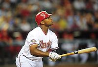 Jun. 27, 2011; Phoenix, AZ, USA; Arizona Diamondbacks outfielder Justin Upton hits an RBI single in the first inning against the Cleveland Indians at Chase Field. Mandatory Credit: Mark J. Rebilas-