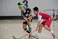 Thailand&rsquo;s Kanya Jantape and Singapore&rsquo;s Wilna Tant in action during the World Floorball Championships 2017 Qualification for Asia Oceania Region - Singapore v Thailand at ASB Sports Centre , Wellington, New Zealand on Sunday 5 February 2017.<br /> Photo by Masanori Udagawa<br /> www.photowellington.photoshelter.com.