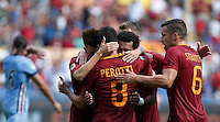Calcio, Serie A: Roma vs Sampdoria. Roma, stadio Olimpico, 11 settembre 2016.<br /> Roma&rsquo;s Mohamed Salah, center, celebrates with teammates after scoring during the Italian Serie A football match between Roma and Sampdoria at Rome's Olympic stadium, 11 September 2016. Roma won 3-2.<br /> UPDATE IMAGES PRESS/Isabella Bonotto