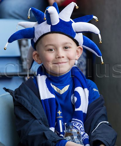 03.04.2016. King Power Stadium, Leicester, England. Barclays Premier League. Leicester versus Southampton.  A young Leicester City FC fan shows off his joker hat and scarf in his team colours.