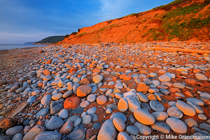 Sunset on shore of the  Gulf os St. Lawrence in Cape Breton<br /> Pleasant Bay<br /> Nova Scotia<br /> Canada