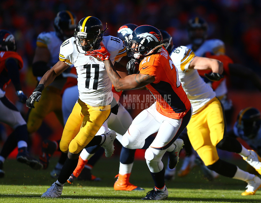 Jan 17, 2016; Denver, CO, USA; Pittsburgh Steelers wide receiver Markus Wheaton (11) against Denver Broncos cornerback Aqib Talib (21) during the AFC Divisional round playoff game at Sports Authority Field at Mile High. Mandatory Credit: Mark J. Rebilas-USA TODAY Sports