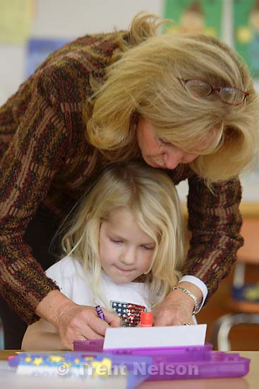 Centerville - Kindergarten teacher Carolee Flannery helps Caoilfhionn Herrmann with a class project Wednesday afternoon at Centerville Elementary.<br />