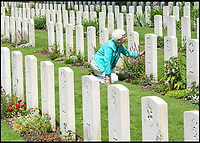 BNPS.co.uk (01202 558833)<br /> Pic: PhilYeomans/BNPS<br /> <br /> Trooper Edmunds grave at the Oosterbeek cemetery near Arnhem.<br /> <br /> As the 75th anniversary of Operation Market Garden begins tomorrow, one of the original 'flower girl''s of Arnhem is still remembering...<br /> <br /> A heartwarming tale of dedication and rememberance has been revealed over a remarkable Dutch pensioner who still tends the grave of a fallen British Arnhem hero, 75 years after he perished in battle.<br /> <br /> Every year, Willemien Rieken (84) still lays flowers at Oosterbeek War Cemetery in memory of Trooper William Edmond, who was shot by a German sniper in the early stages of Operation Market Garden in 1944.<br /> <br /> Trp Edmond, of the elite 1st Airborne Reconnaissance Squadron's final words, uttered to two comrades who came to his aid, were 'tell my wife I love her'.<br /> <br /> Willemien was just nine years old when Oosterbeek became a bloody battleground in September 1944. The retired director's secretary, now aged 84, hid in a small cellar underneath her father's confectionary shop for five days while fierce fighting raged around their house and garden.<br /> <br /> Twenty-five of her family, friends and neighbours packed into the confined space and cowered in fear in the deafening din of shooting and explosions.<br /> <br /> After the war the grateful citizens of Arnhem arranged a poignant ceremony involving a nine year old Willimein and other school children from the town, to lay flowers at the graves of the British soldiers killed in the battle. <br /> <br /> And the dedicated pensioner is now one of the last survivors to still undertake the task.