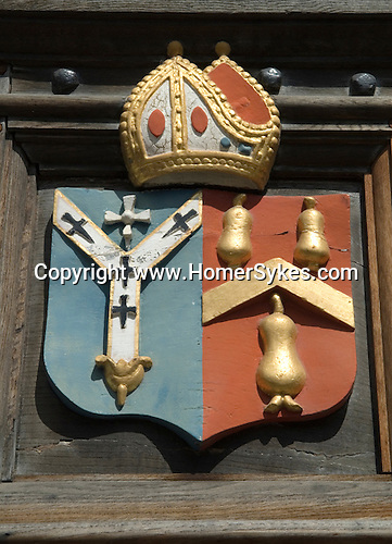 George Abbot Coat of Arms, above the doorway entering the george Abbot Hospital Almshouse.  Guildford High Street House. Surrey Uk.