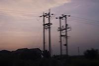"""Electricity pylons.  Guide to Electric Power in Ghana: """"With a customer base of approximately 1.4 million, it has been estimated that 45-.47 percent of Ghanaians, including 15- 17 percent of the rural population, have access to grid electricity with a per capita electricity consumption of 358 kWh.... Electricity demand will grow much faster than overall eco- nomic growth (4-5 percent per year) or than population growth (which is less than two percent a year) because continuing urbanization will allow newly urbanized segments of the population to expand their electricity consumption manifold... Ghanaian governments have been pursuing a national electrification policy. Still, more than half of the population remains without access to grid-based electricity. It is very expen- sive to build long-distance trans- mission lines to serve small communi- ties,.especially.when.these communities are relatively poor and cannot afford to pay rates high enough to cover the cost of these services."""""""