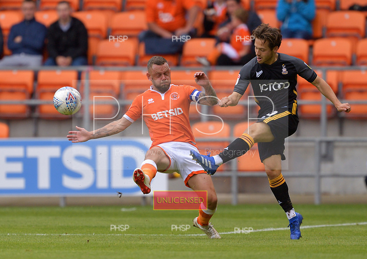 08/09/2018 Sky Bet League 1 Blackpool v Bradford City<br /> <br /> Jack Payne crosses under pressure from Jay Spearing