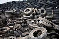 Used tires stand in a junkyard to be recycled in Linxia, Gansu, China.