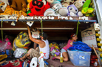 NWA Democrat-Gazette/JASON IVESTER <br /> Chase Meche (cq) of Lafayette, La., and Shirley Macaluso (cq) of Ponchatoula, La., clean and setup one of the midway games on Monday, Aug. 3, 2015, for the 117th Tontitown Grape Festival. The festival opens today and continues through Saturday.