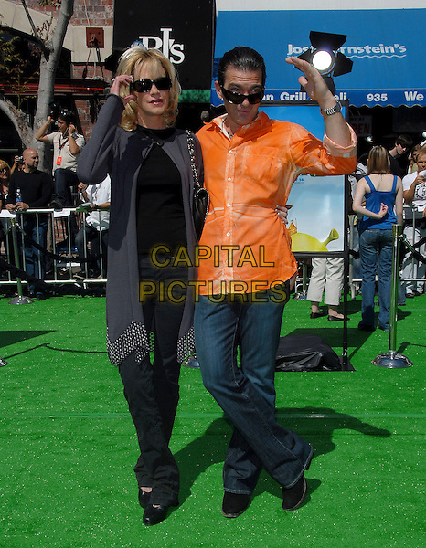 "MELANIE GRIFFITH & ANTONIO BANDERAS .attends The Dreamworks L.A. Premiere of ""Shrek The Third"" held at The Mann Village Theatre in Westwood, California, USA, May 06 2007..full length orange shirt sunglasses married husband wife.CAP/DVS.©Debbie VanStory/Capital Pictures"