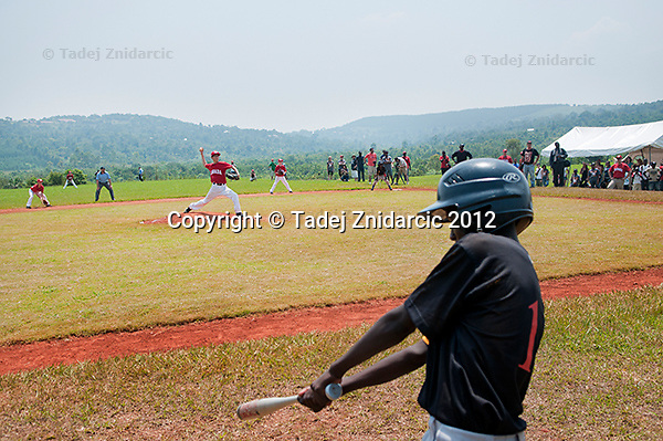 Ugandan player Augustus Owinyi prepares before his turn to strike during the game in Mpigi, Uganda on January 17 2012 between Ugandan Little League team and Canadian Little League team from Langley.