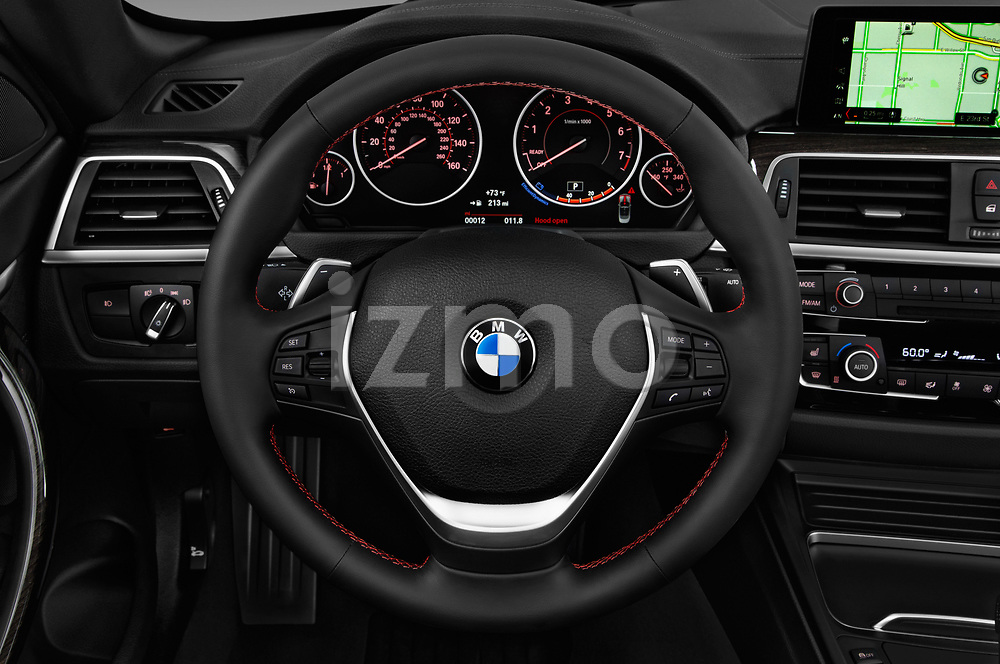 Car pictures of steering wheel view of a 2020 BMW 4 Series 430i 2 Door Convertible