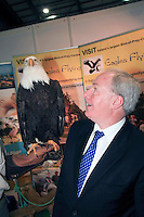 NO REPRO FEE: 27.1.12: Minister of State at the Department of Tourism, Michael Ring TD, officially opens the Holiday World Show Dublin at the RDS Simmonscourt. Pictured was an American Eagle from Irish Raptor Research Centre, Ballymote, Co Sligo with Minister of State at the Department of Tourism, Michael Ring TD. The Show runs until 5.30pm on Sunday 29th January.  Picture Collins Photos.