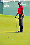 30 August 2009: Tiger Woods misses his birdie putt on the 18th hole during the final round of The Barclays PGA Playoffs at Liberty National Golf Course in Jersey City, New Jersey.