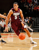 CHARLOTTESVILLE, VA- December 27: Louis Bell #5 of the Maryland-Eastern Shore Hawks handles the ball during the game against the Virginia Cavaliers on December 27, 2011 at the John Paul Jones Arena in Charlottesville, Va. Virginia defeated Maryland Eastern Shore 69-42.  (Photo by Andrew Shurtleff/Getty Images) *** Local Caption *** Louis Bell