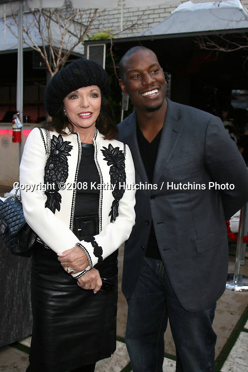 Joan Collins & Tyson Beckford.Tyson asked for Joan to pose for his personal camera after meeting her at the GBK Gifting Suites.GBK Productions Oscar Gifting Suite.Boulevard3.Los Angeles, CA.February 22, 2008.©2008 Kathy Hutchins / Hutchins Photo....