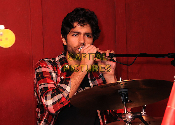 "ADRIAN GRENIER.""Adventures of Power"" DVD Launch and Charity Auction Benefiting VH1's Save The Music Foundation held at Bar Lubitsch, Hollywood, California, USA, 27th January 2011..half length beard facial hair red plaid black shirt music drums drumming playing drummer band on stage concert gig live microphone singing .CAP/ADM/BP.©Byron Purvis/AdMedia/Capital Pictures."