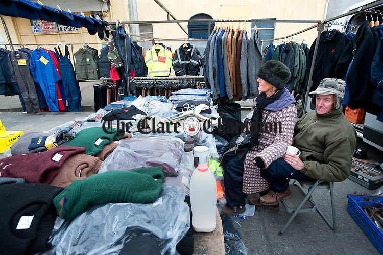 Mary and John Flynn of South Tipperary wait for customers in their street stall during a very quiet  Kilrush Horse Fair on Monday. Photograph by John Kelly.