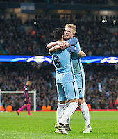 Kevin De Bruyne of Manchester City congratulates Ilkay Gundogan of Manchester City on his 2nd goal during the UEFA Champions League match between Manchester City and Barcelona at the Etihad Stadium, Manchester, England on 1 November 2016. Photo by Andy Rowland / PRiME Media Images.