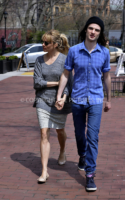 WWW.ACEPIXS.COM....April 15 2013, New York City....Actors Sienna Miller and Tom Sturridge enjoy a spring walk around the West Village on April 15 2013 in New York City......By Line: Curtis Means/ACE Pictures......ACE Pictures, Inc...tel: 646 769 0430..Email: info@acepixs.com..www.acepixs.com