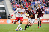 Dane Richards (19) of the New York Red Bulls under pressure from Wells Thompson (15) of the Colorado Rapids. The New York Red Bulls defeated the Colorado Rapids 4-1 during a Major League Soccer (MLS) match at Red Bull Arena in Harrison, NJ, on March 25, 2012.