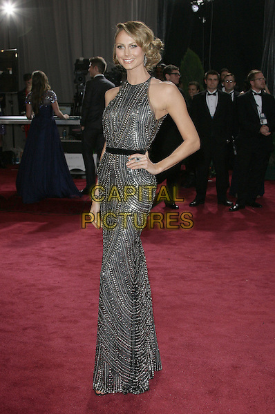 Stacy Keibler.85th Annual Academy Awards held at the Dolby Theatre at Hollywood & Highland Center, Hollywood, California, USA..February 24th, 2013.oscars full length black grey gray silver metallic sleeveless beads beaded dress belt hand on hip  .CAP/ADM.©AdMedia/Capital Pictures.