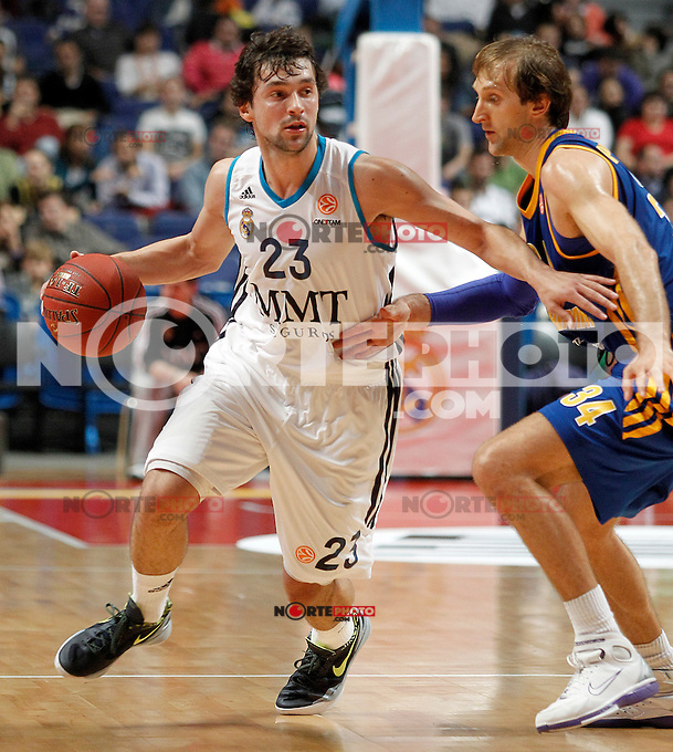 Real Madrid's Sergio Llull (l) and BC Khimki MR's Zoran Planinic during Euroleague 2012/2013 match.November 23,2012. (ALTERPHOTOS/Acero) /NortePhoto