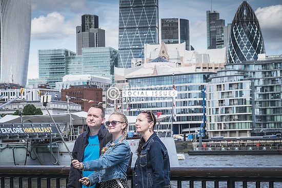 A family taking a selfie on the South Bank in London.