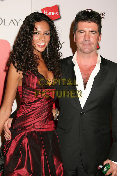 TERRI SEYMOUR & SIMON COWELL.The TV Guide After Party following the 58th Annual Primetime Emmy Awards, Los Angeles, California, USA..August 27th, 2006.Ref: ADM/BP.half length Teri red black couple.www.capitalpictures.com.sales@capitalpictures.com.©Byron Purvis/AdMedia/Capital Pictures.