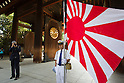 August 15, 2011 - Tokyo, Japan - A man dressed in a Japanese military uniform proudly holds up the flag of Japan at Yasukuni Shrine. Thousands of people visit this shrine to pay their respect to the Japanese war soldiers who died fighting in World War II which marks the 66th anniversary of the end of WWII. (Photo by Christopher Jue/AFLO)