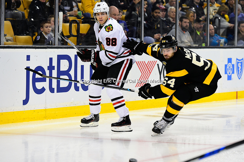 Friday, January 20, 2017: Boston Bruins defenseman Adam McQuaid (54) and Chicago Blackhawks right wing Patrick Kane (88) watch the track of the puck during the National Hockey League game between the Chicago Blackhawks and the Boston Bruins held at TD Garden, in Boston, Mass. Chicago defeats Boston 1-0 in regulation time. Eric Canha/CSM