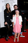 """HOLLYWOOD, CA. - October 20: Writer/director Kevin Smith, wife Jennifer and daughter Harley arrive at the Los Angeles Premiere of """"Zack And Miri Make A Porno"""" at the Grauman's Chinese Theater on October 20, 2008 in Hollywood, California."""