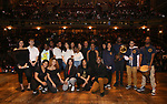 MC Host Justin Dine Bryant with student performers  during the an eduHAM Q & A panel with the cast of Broadway's 'Hamilton' at The Richard Rodgers Theatre on May 23, 2018 in New York City.
