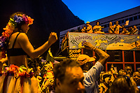 RIO DE JANEIRO, BRAZIL - FEBRUARY 23, 2014: Andr&eacute; da Silva Lisboa, 38, better known by his nickname, Andr&eacute; Poetry, a samba singer and a janitor at a McDonald&rsquo;s, who has been diagnosed with schizophrenia, sings atop of the float during the annual T&aacute; Pirando, Pirado, Pirou! carnival street parade on February 23, 2014 in Rio De Janeiro, Brazil. It looks like any of the other 450 or so street parties, locally called &ldquo;carnival blocks,&rdquo; that parade through Rio de Janeiro during the raucous pre-Lenten festivities that draw hundreds of thousands to the city each year. What makes this party different are its performers and organizers: psychiatric patients and their doctors, therapists, family members, neighbors and passers-by. The group, called T&aacute; Pirando, Pirado, Pirou!, which roughly translates as &ldquo;We&rsquo;re freaking out, we already freaked out!&rdquo;, began ten years ago when Brazil was in the process of dismantling its century-old system of mental asylums. A law passed in 2001 called for long-term outpatient psychiatric care to be offered primarily in community clinics. The number of such clinics increased more than fivefold in the following decade, while the number of asylum beds for psychiatric patients dropped 40 percent nationwide.<br /> <br /> Daniel Berehulak for The New York Times
