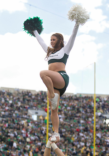 September 21, 2013:  Michigan State cheerleader performs during NCAA Football game action between the Notre Dame Fighting Irish and the Michigan State Spartans at Notre Dame Stadium in South Bend, Indiana.  Notre Dame defeated Michigan State 17-13.