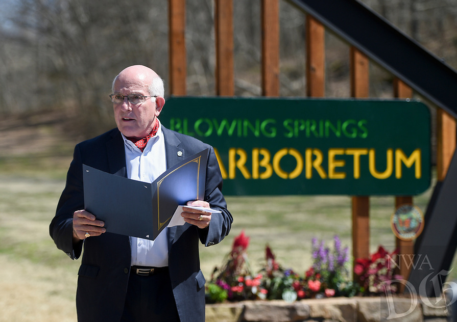 NWA Democrat-Gazette/CHARLIE KAIJO Bella Vista Mayor Peter Christie gives a proclamation during an Arbor Day celebration, Monday, March 18, 2019 at Blowing Springs Park in Bella Vista. <br />