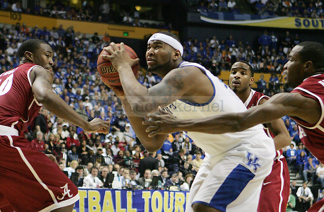 Freshman forward DeMarcus Cousins gets past Alabama defense during the second half of the UK mens basketball team's 73-67 win over Alabama in the quarterfinals of the SEC tournament at the Sommet Center Friday, March 12, 2010. Photo by Britney McIntosh | Staff