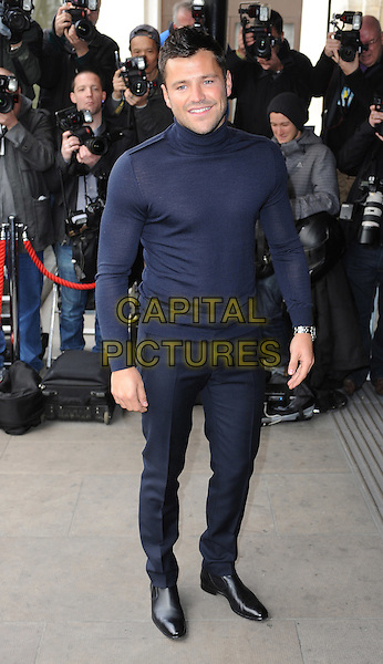 Mark Wright.The TRIC ( TV & Radio Industries Club ) Awards, Grosvenor House Hotel, Park Lane, London, England..13th March 2012.full length black trousers top .CAP/BEL.©Tom Belcher/Capital Pictures.