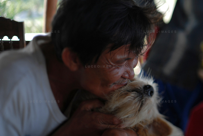 A man plays with his dog in Hoi An, Vietnam.