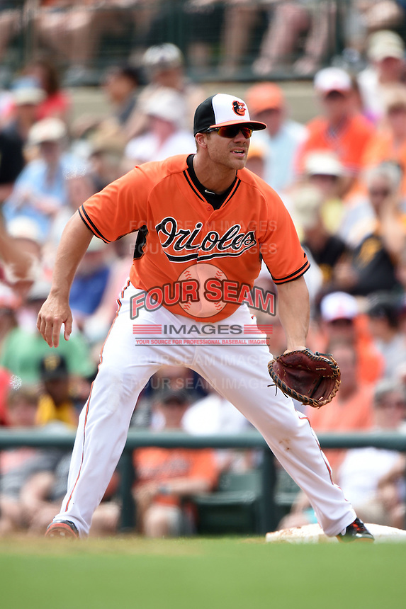 Baltimore Orioles first baseman Chris Davis (19) during a spring training game against the Pittsburgh Pirates on March 23, 2014 at Ed Smith Stadium in Sarasota, Florida.  Baltimore and Pittsburgh tied 7-7.  (Mike Janes/Four Seam Images)
