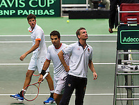 01-02-14,Czech Republic, Ostrava, Cez Arena, Davis Cup Czech Republic vs Netherlands,Robin Haase(NED) gets irritated and Jean-Julien Rojer(NED) (M) and captain Jan Siemerink discus with the umpire  <br /> Photo: Henk Koster